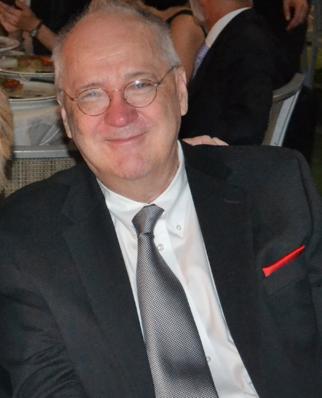 Prof. Arch G. Woodside